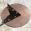 8in unsigned bronze sundial with sylised dolphin gnomon c.1860
