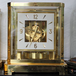 A fairly common Jaeger LeCoultre Atmos 'Living On Air' clock 528 calibre with square dial powered by gas-filled bellows on the back