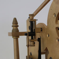 The Congreve rolling ball clock has an adjustable escapement at the back to increase and decrease the angle of the track plate