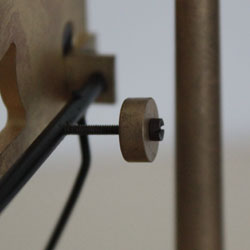 The sensitivity of the Congreve rolling ball clock's tilt levers is made by way of a counterweight at the rear